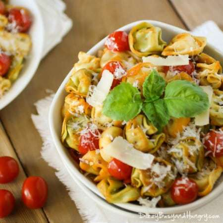 Spicy Skillet Tortellini with Tomatoes | DizzyBusyandHungry.com - Lightly browned cheese tortellini and tomatoes sauteed with red pepper flakes and topped with freshly grated Parmesan cheese! #pasta #tortellini #easyrecipes