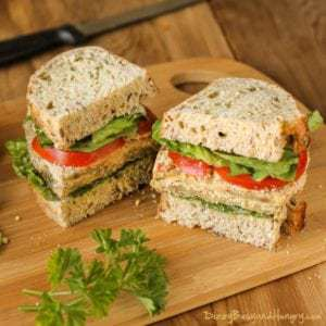 Side view of eggplant Milanese torta cut in half on a wooden cutting board.