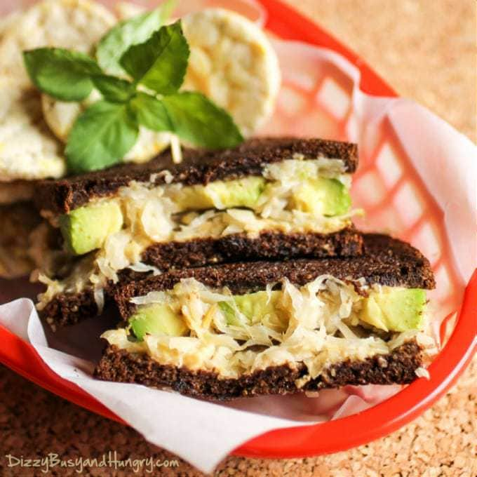 Mom's Grilled Sauerkraut Avocado Sandwich | DizzyBusyandHungry.com - Crunchy, tangy sauerkraut with creamy avocado and hummus on pumpernickel bread grilled until hot and crispy! #sandwich #avocado #hummus #vegan