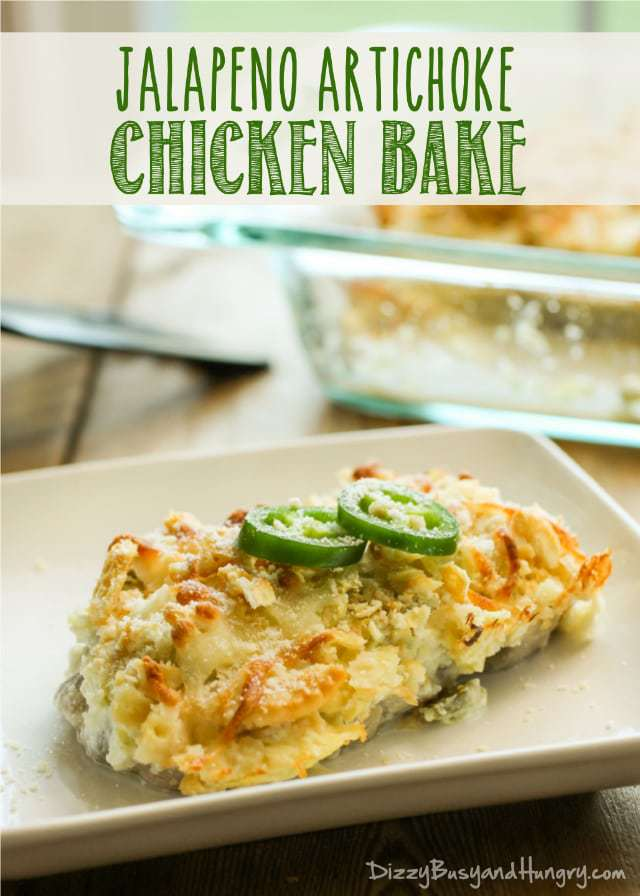 Side view of jalapeño artichoke chicken bake on a white plate with the pan in the background.
