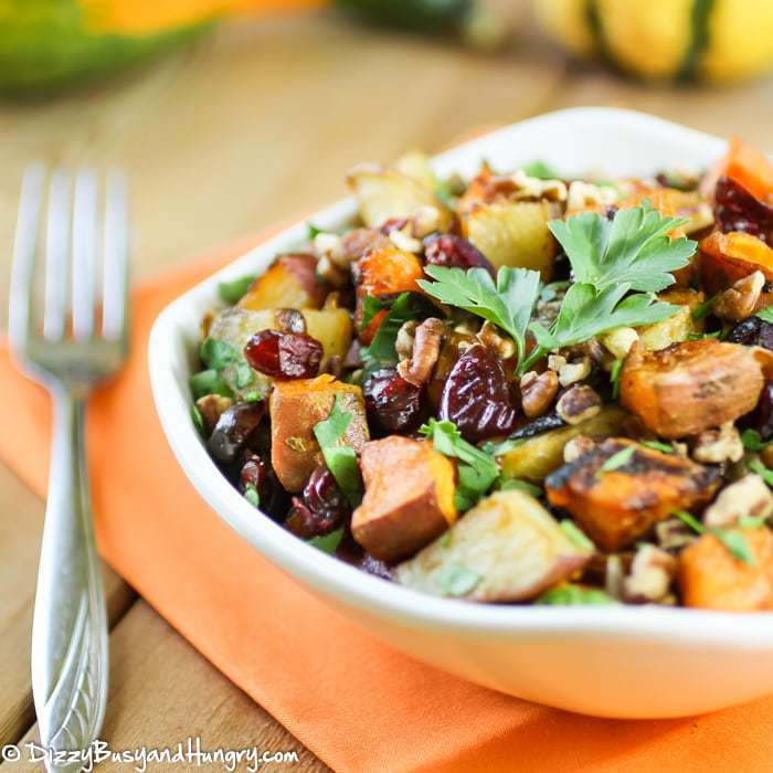 Roasted Potato Medley | DizzyBusyandHungry.com - Sweet potatoes, white potatoes, red potatoes, and red onions roasted in garlic with olive oil and tossed with dried cranberries and pecans.