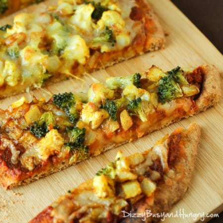 Curried Veggie Pizza | DizzyBusyandHungry.com - Individual vegetarian pizzas slathered with curry-spiced pizza sauce and loaded with delicious veggies!
