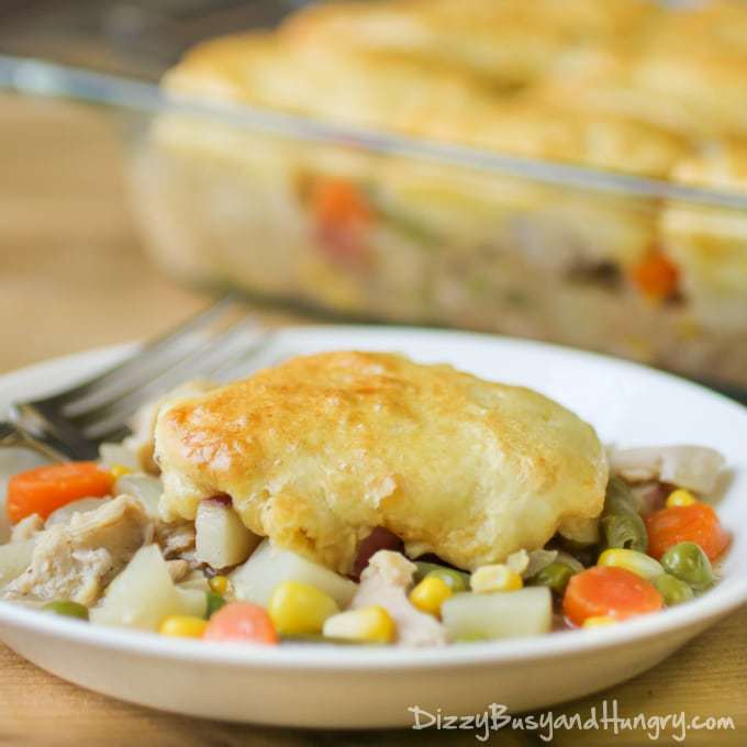 Slow Cooker Chicken and Biscuits | DizzyBusyandHungry.com - Super-easy and delicious chicken and veggies in a creamy sauce topped with flaky, crusty biscuits. We love this dinner!