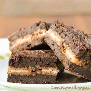 Close up shot of pumpkin Oreo brownies stacked on a white and yellow polka dot plate.