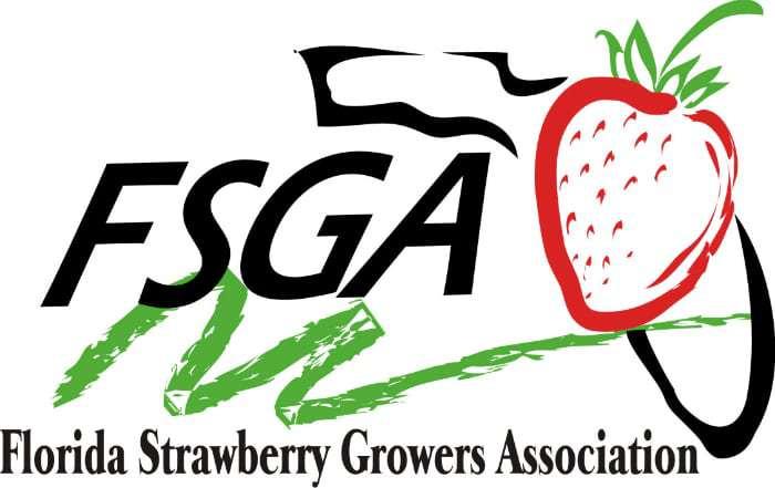 Close up of a FSGA (Florida Strawberry Growers Association) sign.