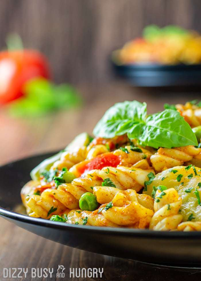 Easy Curry Pasta and Vegetables | DizzyBusyandHungry.com - This is one of my healthy recipes and uses red curry paste, light coconut milk, and frozen vegetables to create a unique and delicious easy weeknight pasta dinner the whole family will love.