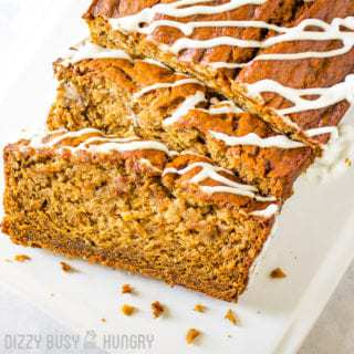 Banana bread sliced and drizzled with vanilla frosting