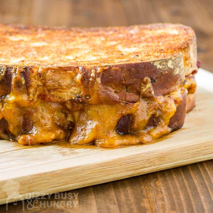 freshly grilled chili cheese sandwich on a cutting board