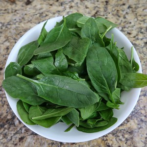 process shot step 1 bowl of fresh spinach leaves