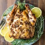overhead view of slow cooker whole chicken with golden brown, crispy skin