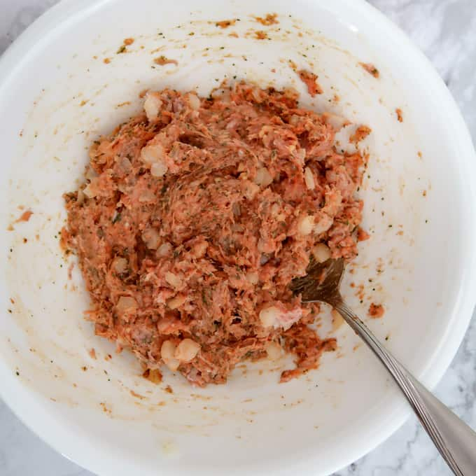 Overhead view of ground tukey mixed with onion, garlic, curry paste, and dried cliantro
