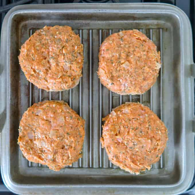 Overhead view of 4 formed patties place on the grill top, ready to be cooked!