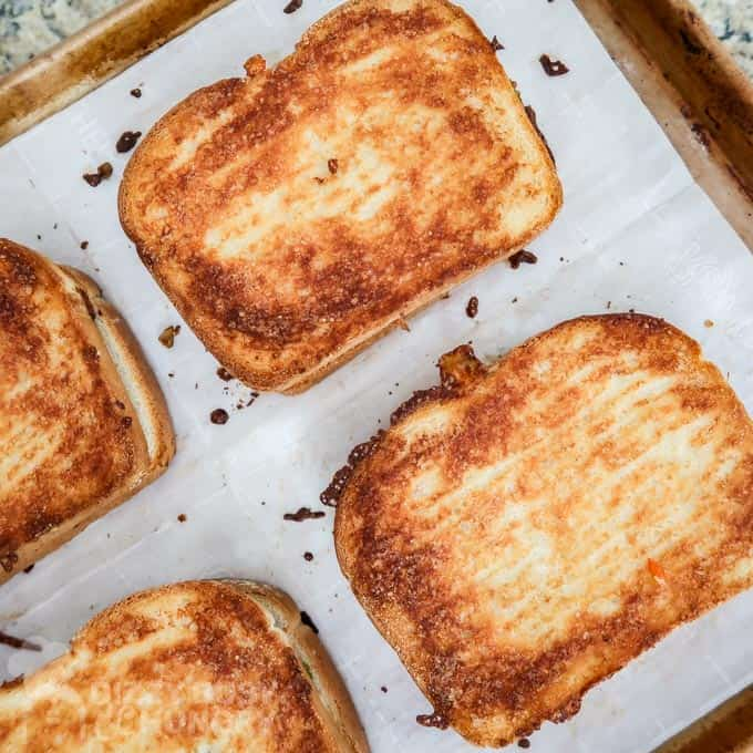 Overhead view of Grilled Chicken Sandwich Recipe with Cheese baked to a crispy golden brown.
