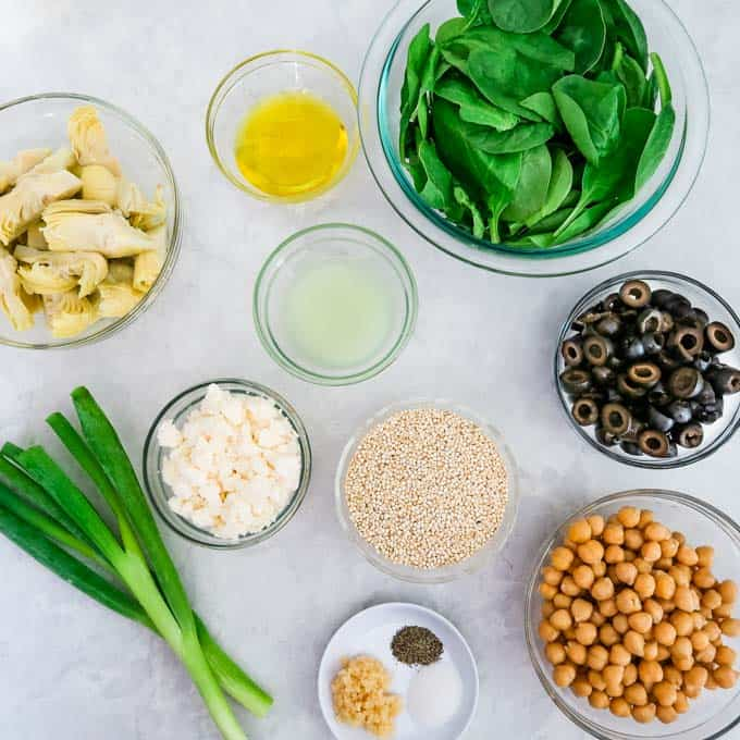 Ingredients- Artichoke hearts, garlic, olive oil, lime juice, salt, pepper, chickpeas, olives, spinach, scallions, and feta.