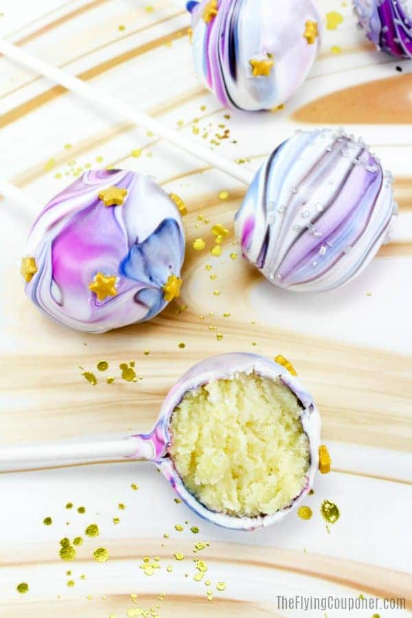 Top view of 4 easy cake pop recipes with galaxy swirl frosting