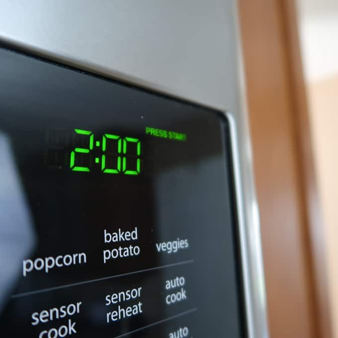 Close up view of microwave set to two minutes.