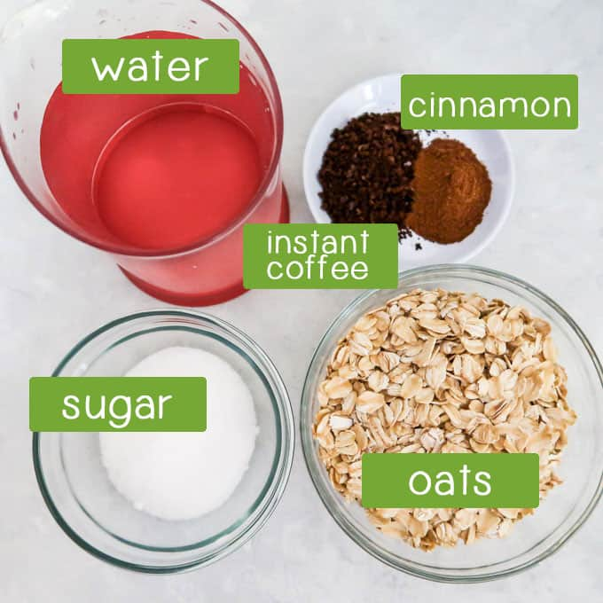 Overhead shot of ingredients- oats, water, instant coffee, cinnamon, and sugar.