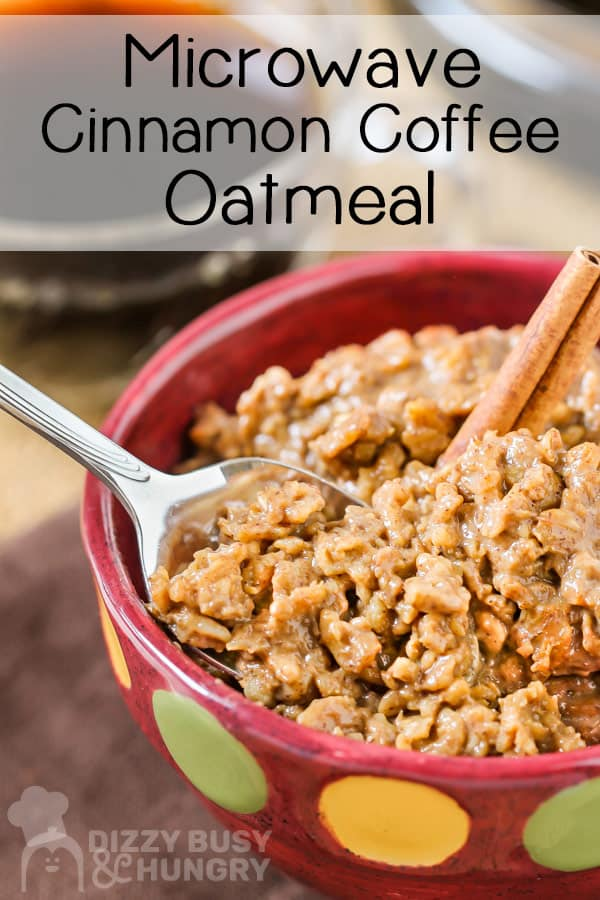 Side view of spoon with oatmeal in a red bowl with cinnamon stick garnish.