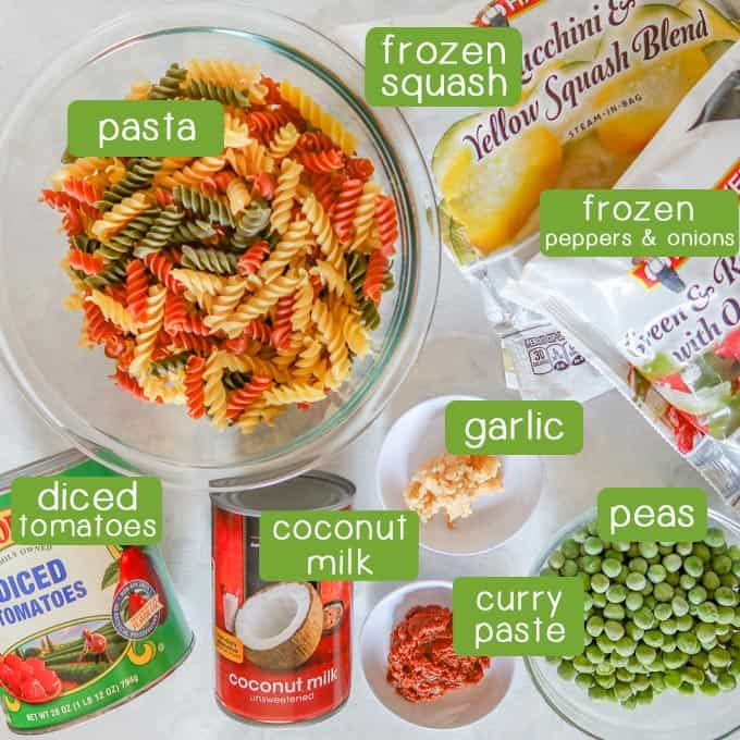 Ingredients- pasta, frozen squash, frozen peppers and onions, garlic, peas, curry paste, coconut milk, and diced tomatoes.