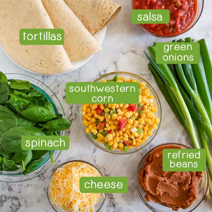 Overhead shots of ingredients- tortillas, salsa, green onions, spinach, southwestern corn, refried beans, and shredded cheese.