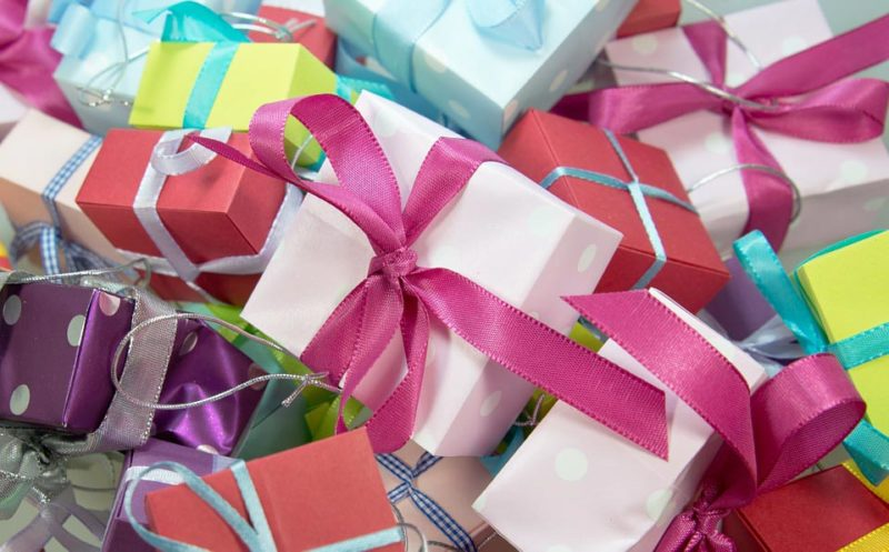 Close up of small colorful gift boxes with ribbons.