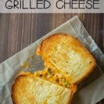 Overhead view of grilled cheese sandwich with yummy cheese pull.