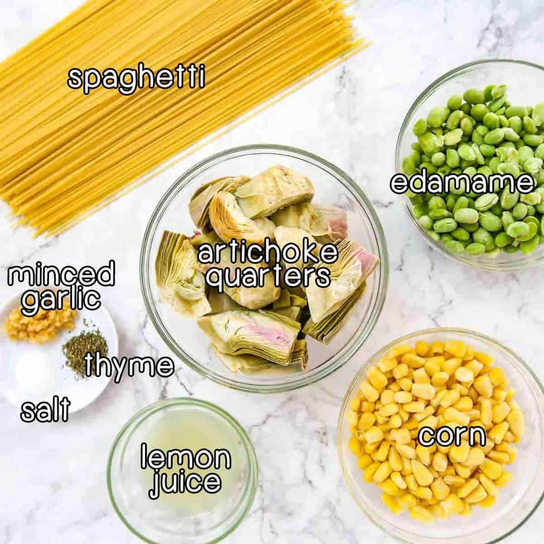 Overhead photo of all the ingredients needed to make lemon artichoke pasta.