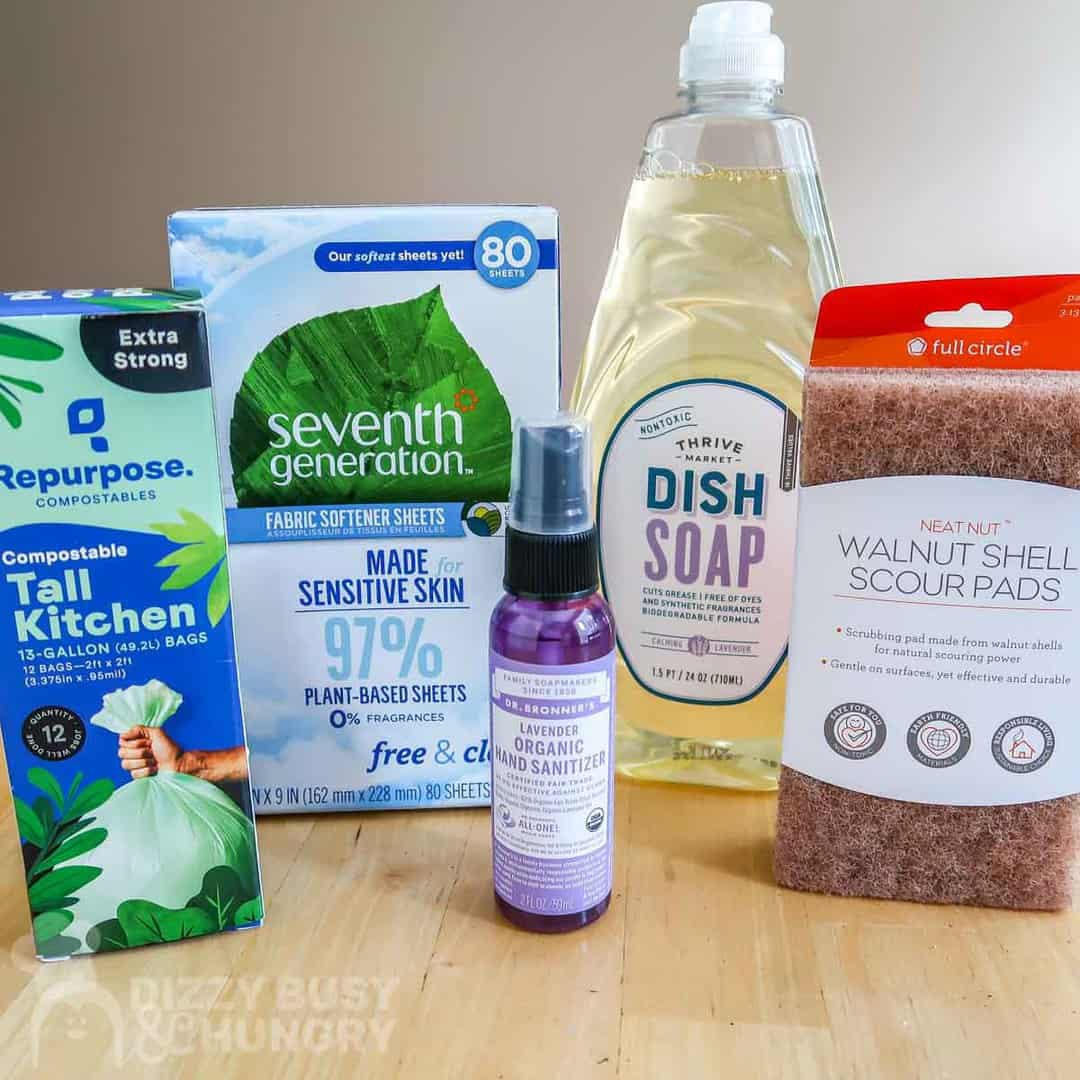 Photo of some thrive market household products like garbage bags, dryer sheets, dish soap, hand sanitizer spray.