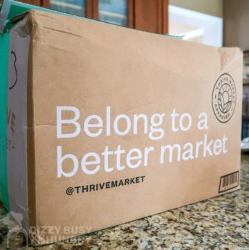 Photo of Thrive Market shipping box on a kitchen counter.