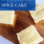 top view of square slices of pumpkin spice cake topped with cream cheese frosting