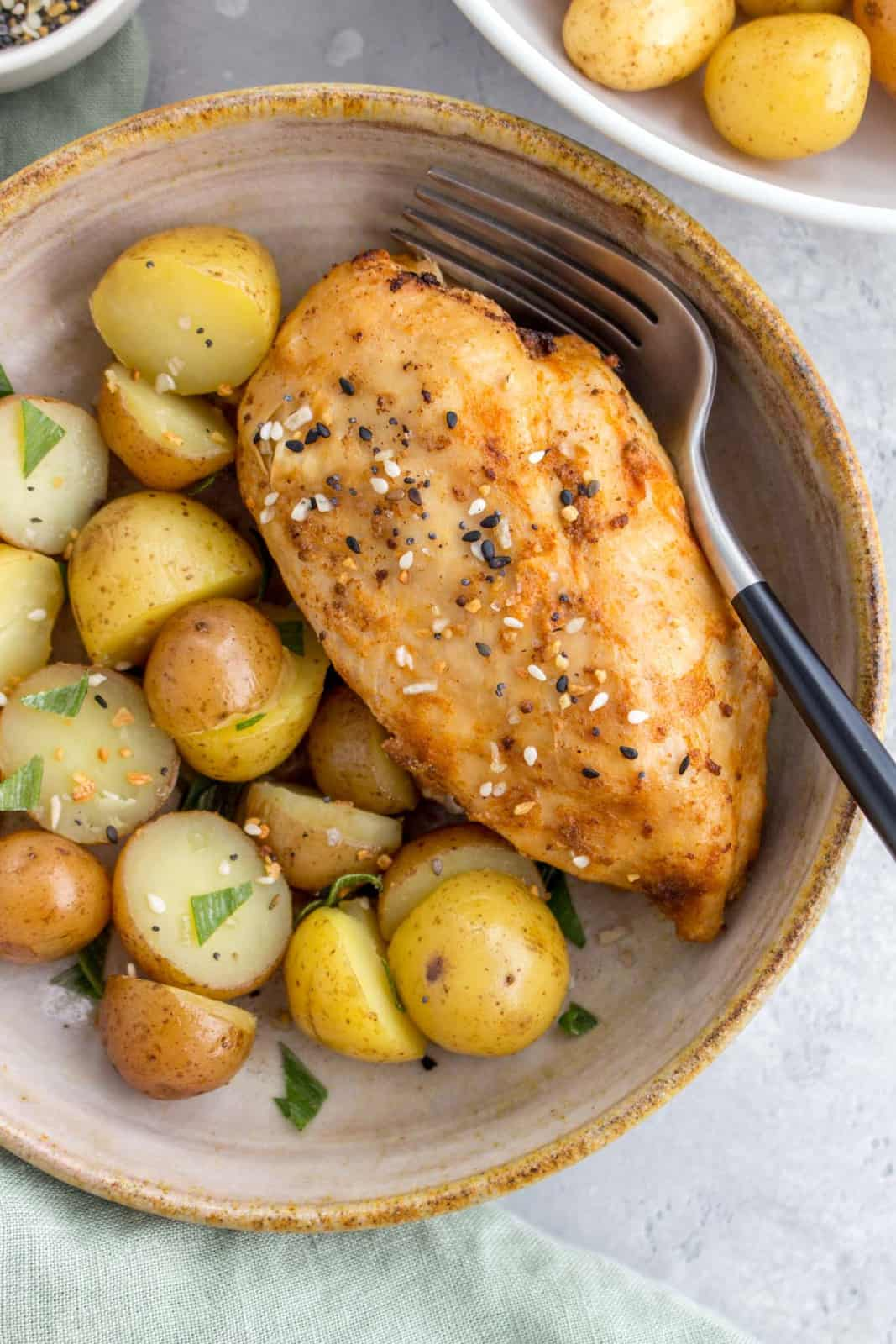 close up of bowl of instant pot chicken breasts and potatoes