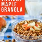 Side view of crunchy baked homemade granola topped with chopped apple.