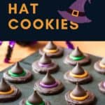 Side view of many finished witch hats made with round crackers, chocolate chips, and chocolate kisses.
