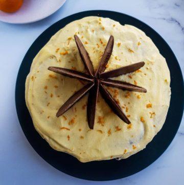 Orange chocolate cake decorated with chocolate oranges.
