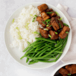 overhead shot of pork, green beans, and white rice