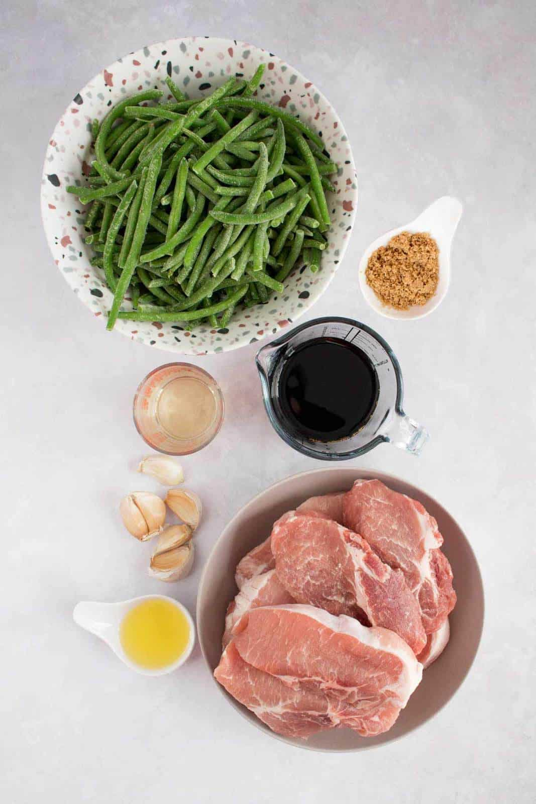 Overhead image of ingredients required to make braised pork and vegetables.