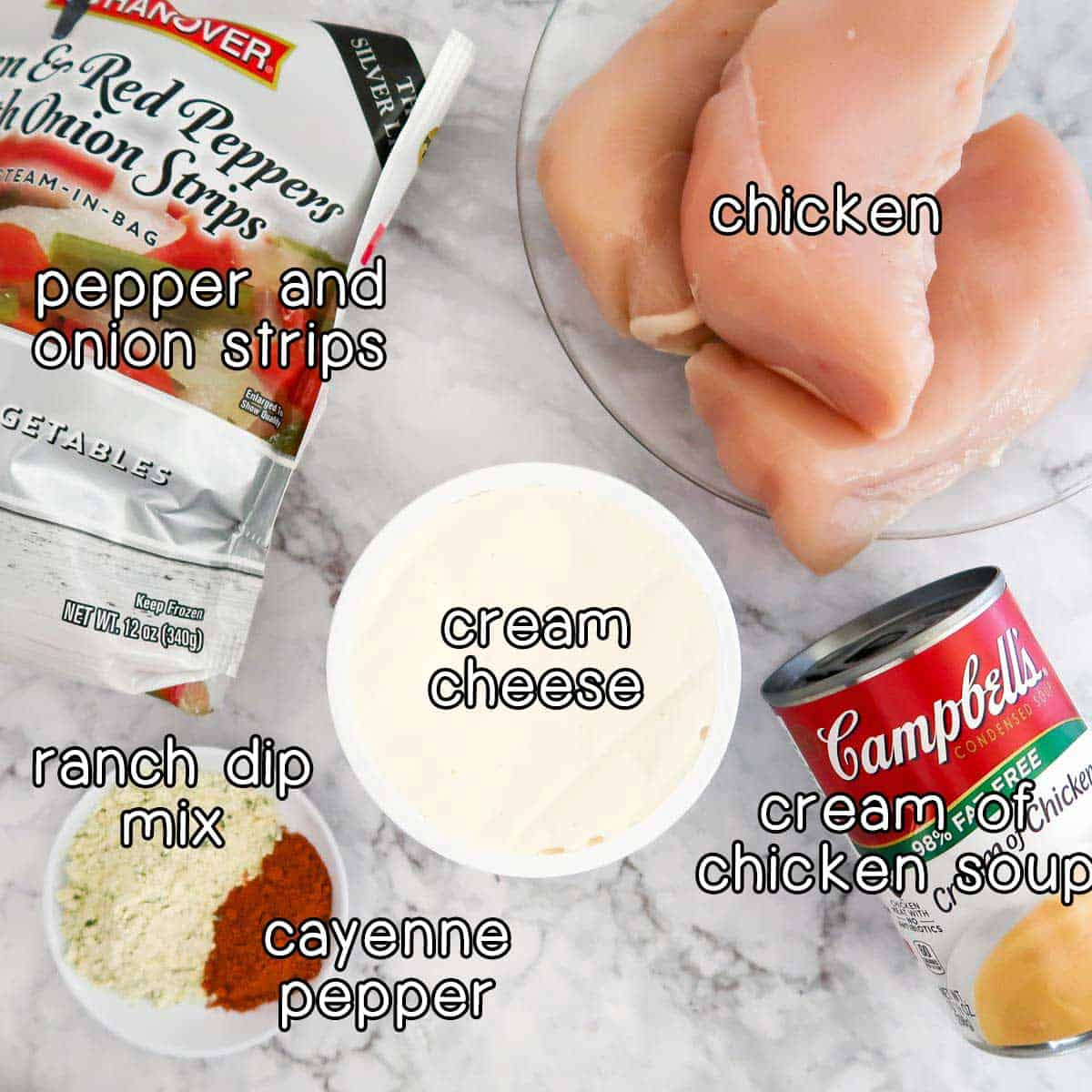 Overhead shot of ingredients- chicken, pepper and onion strips, cream cheese, cream of chicken soup, ranch dip mix, and cayenne pepper.