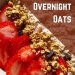 closeup of oats garnished with fresh sliced strawberries.