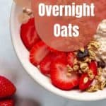 closeup of oats garnished with fresh sliced strawberries surrounded by whole strawberries.