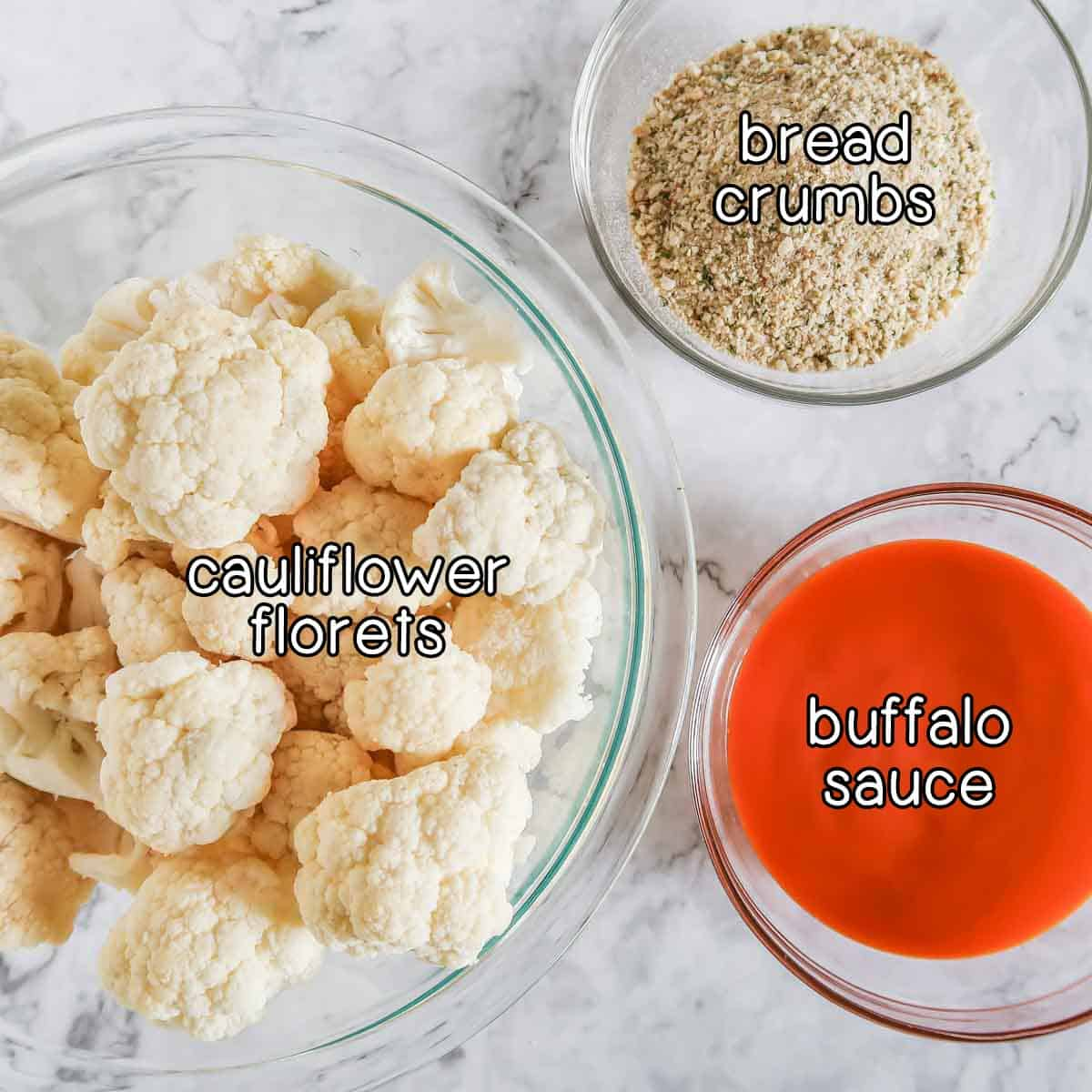 Overhead shot of ingredients- cauliflower florets, bread crumbs, and buffalo sauce.