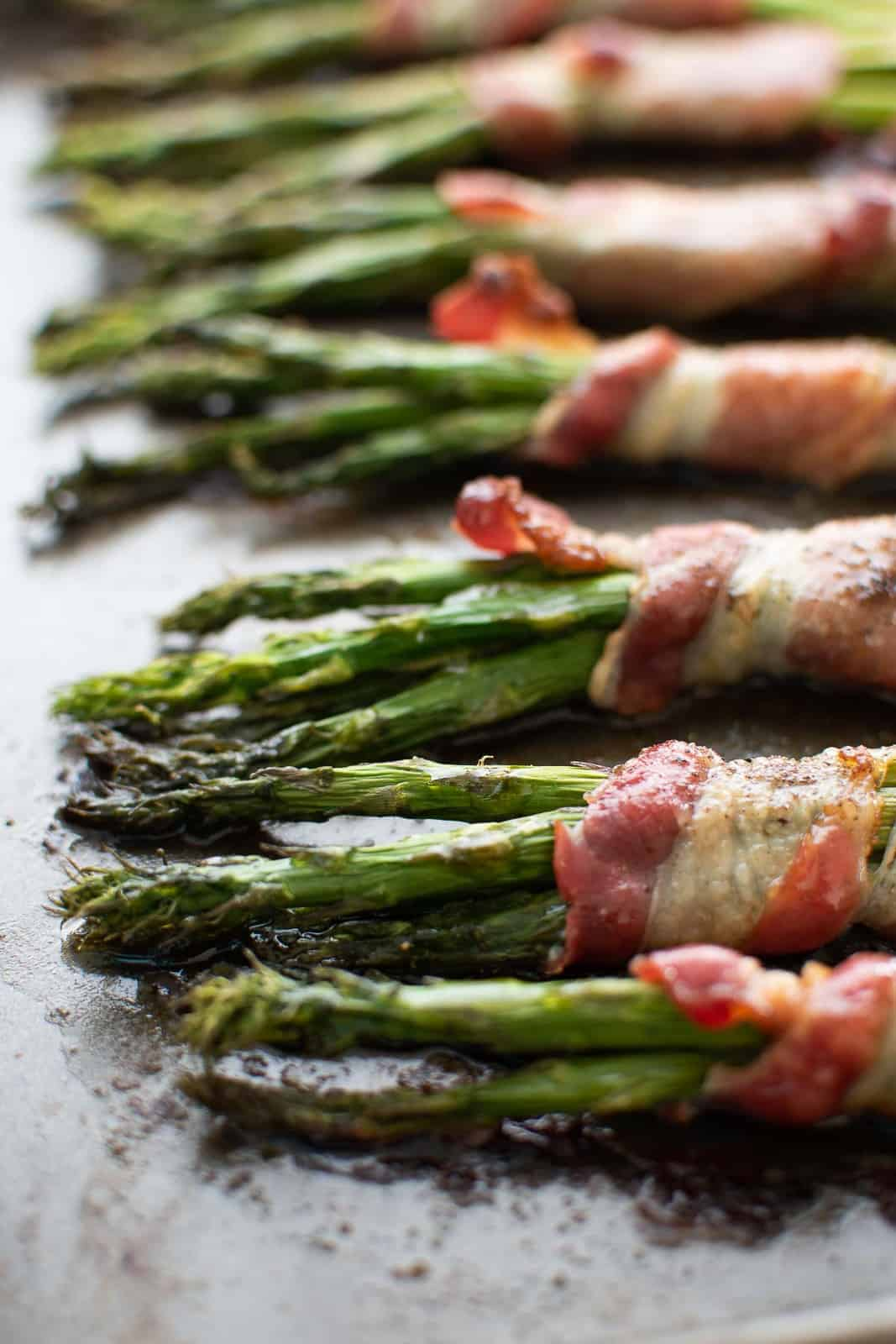 Roasted asparagus wrapped in bacon.