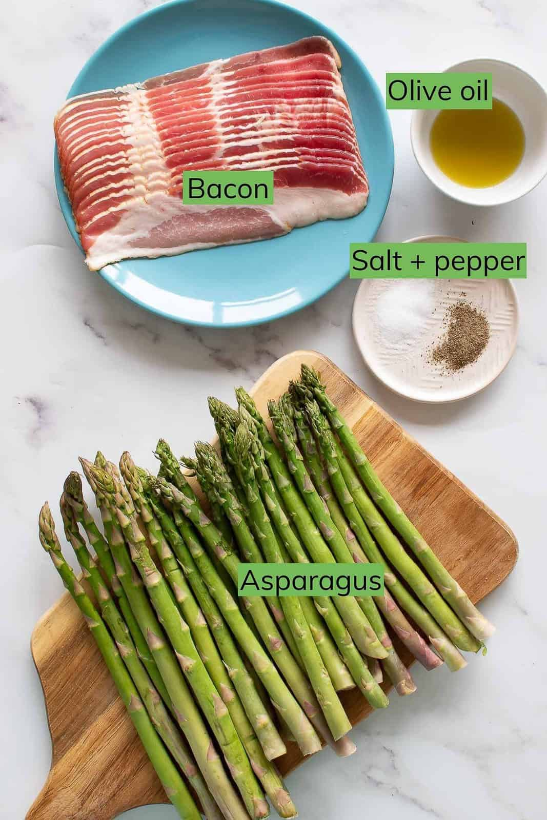 The ingredients for bacon wrapped asparagus laid out on a table.