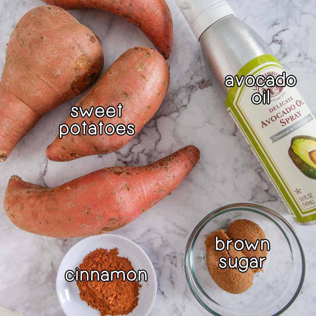 Overhead view of 4 ingredients needed to make this recipe - sweet potatoes, spray oil, cinnamon, brown sugar.