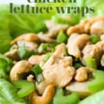 Close up shot of lettuce wrap garnished with cashews and scallions on a white plate.