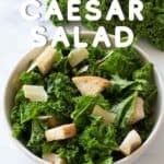 Bowl of kale caesar salad with croutons.