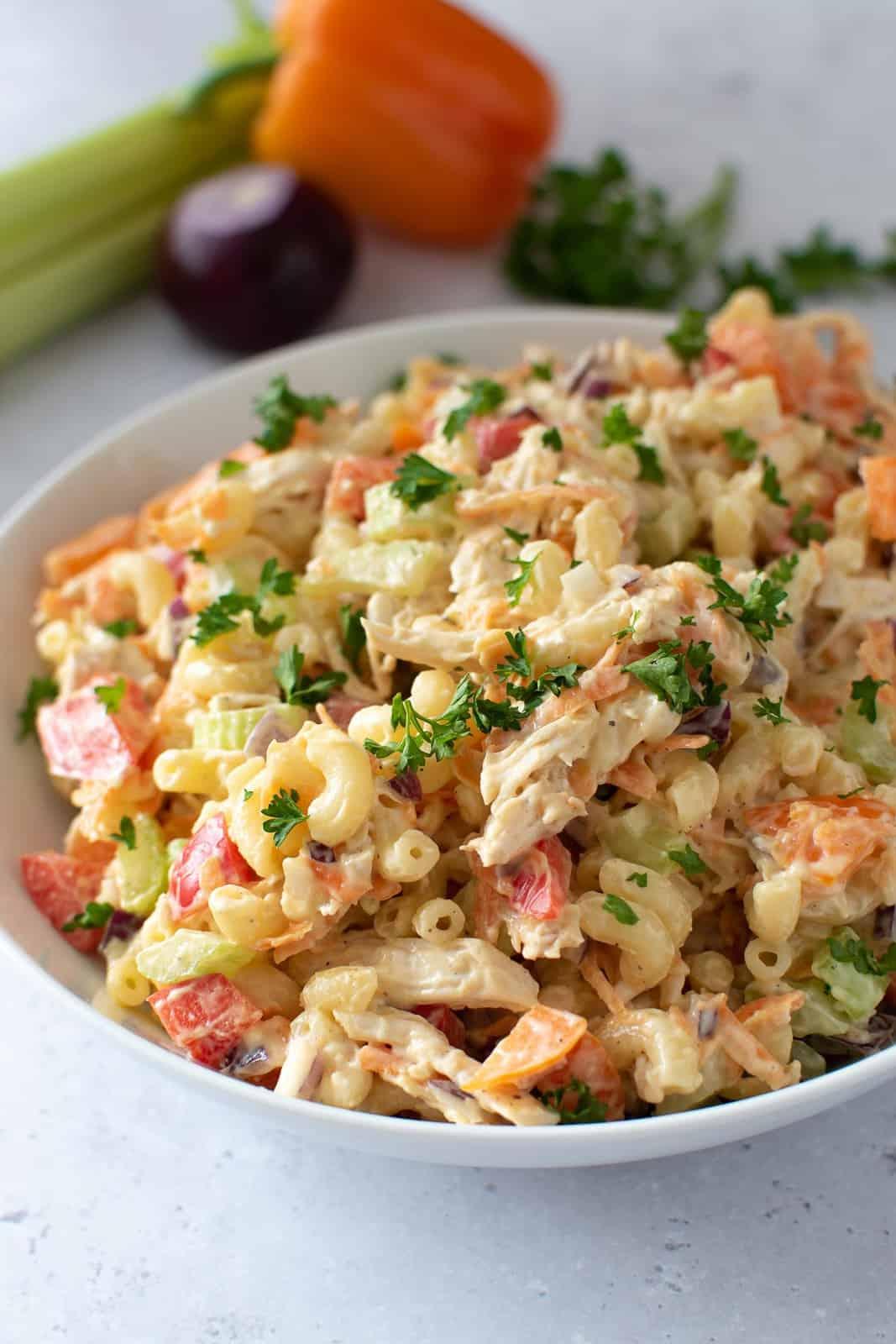 A bowl of chicken macaroni salad.