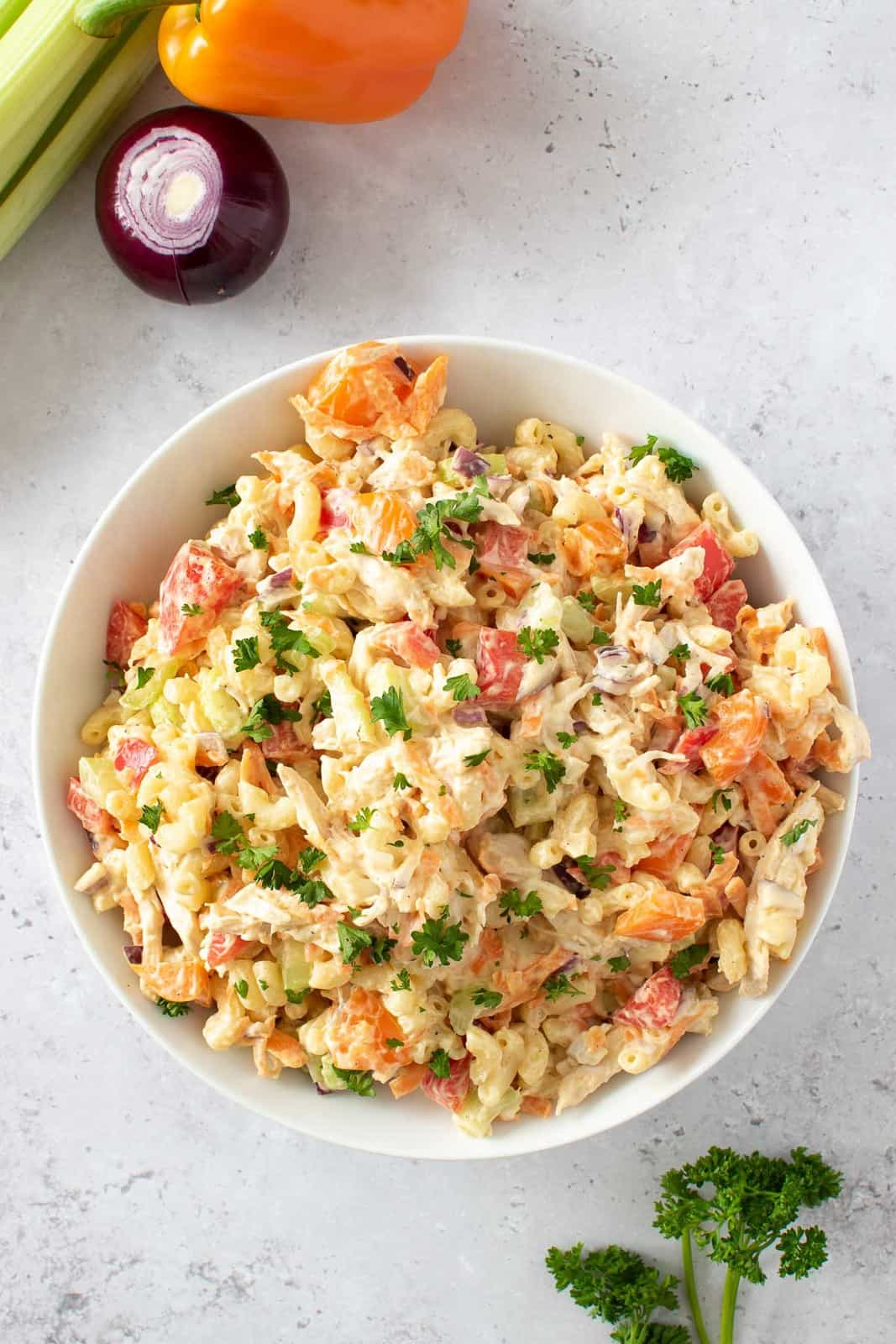 Chicken and macaroni salad with mayonnaise and vegetables.