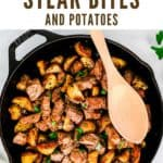 Overhead view of cast iron skillet with cooked steak bites and potatoes garnished with chopped parsley.
