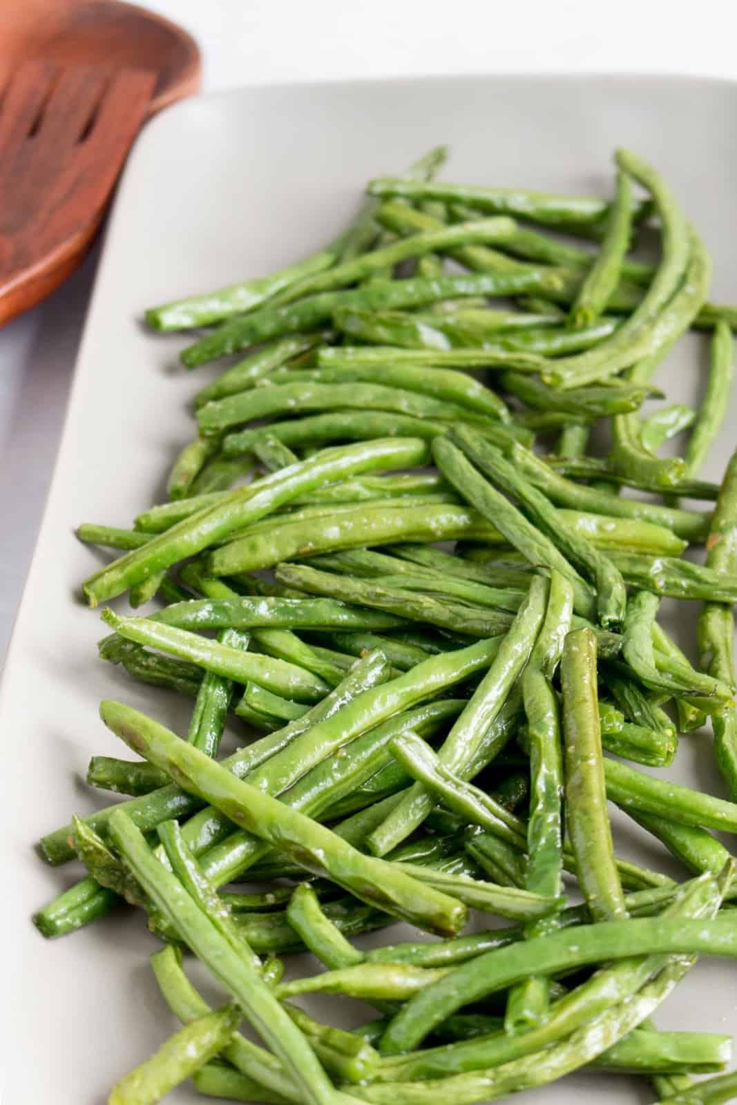 Air fryer green beans on a platter.