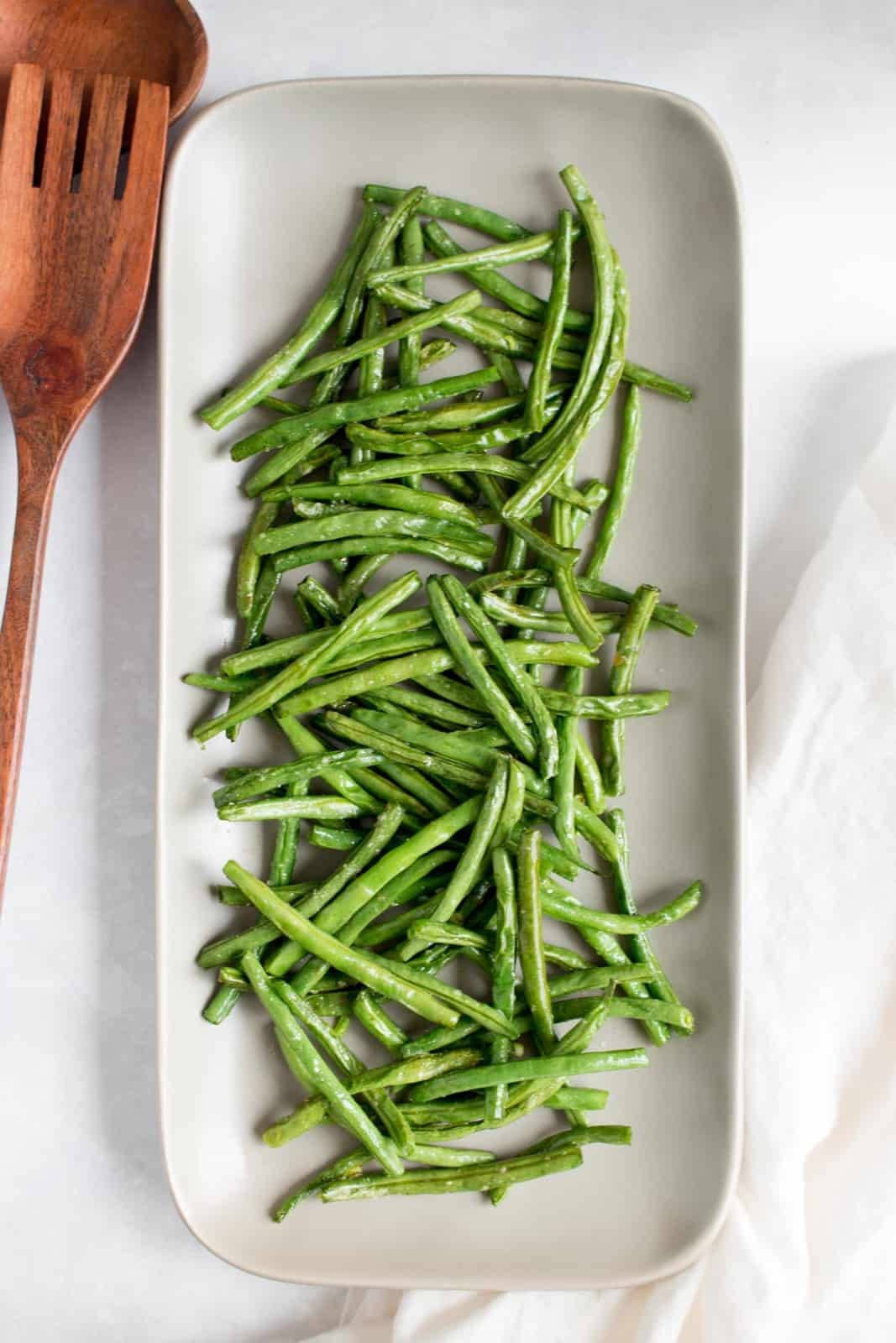 Overhead view of a platter of air fryer green beans.